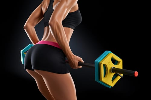 Closeup portrait of beautiful fitness woman training with barbell at gym-img-blog