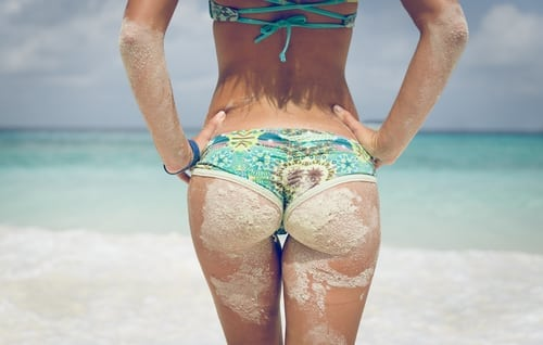 woman buttock dirty with sand with beautiful clear water