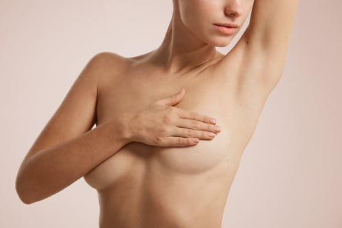 portrait young woman with breast pain touching chest