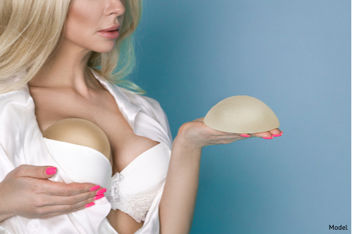 woman deciding which implants to choose