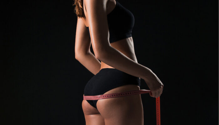 woman measuring butt shape Show less